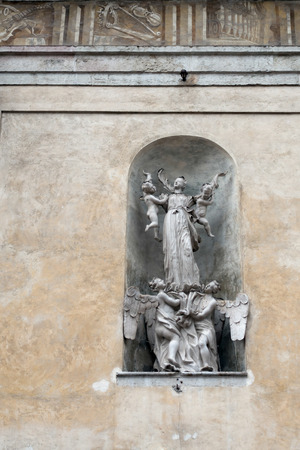 trentino: Angels and Babies Statue on the facade of the Collegiate Church in Arco Trentino Italy