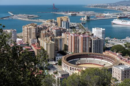 bullring: View of the Harbour Area and Bullring in Malaga Editorial