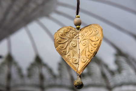 dangling: Golden Decorative Heart  Dangling from a Parasol in Marbella