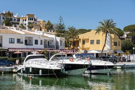 pino: Boats Moored in Cabo Pino Harbour Editorial