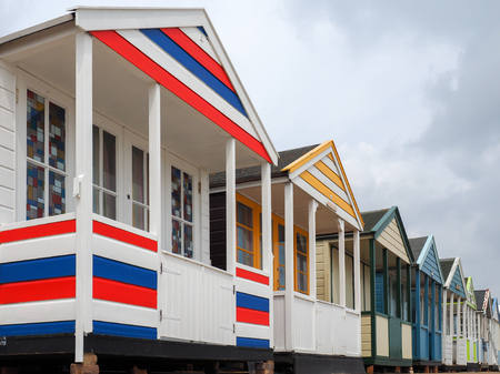 southwold: A Row of Brightly Coloured Beach Huts in Southwold Stock Photo