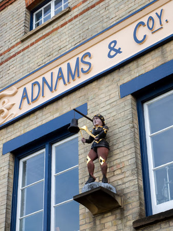 southwold: Statue of a Boy Hitting a Bell outside Adnams Brewery in Southwold Editorial