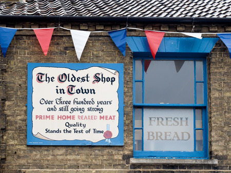 commemorating: Sign outside a Shop in Southwold Commemorating over 300 Years of Trading Editorial