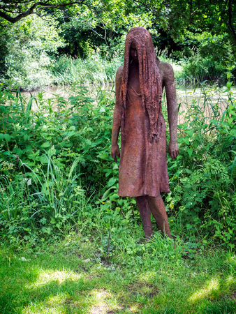 rusting: Rusting Statue of a Young Lady in the Gounds of Michelham Priory