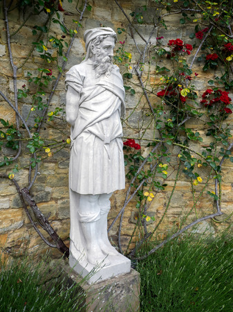 statuary garden: Old Statue of a Bearded Man in the Garden at Hever Castle