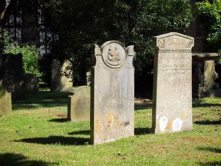 headstones: Headstones in St Swithuns Church Graveyard in East Grinstead Editorial
