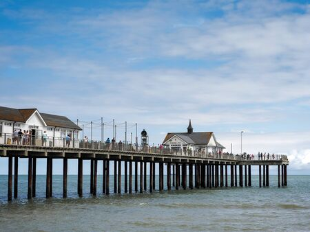 southwold: People Enjoying a Sunny Day Out on Southwold Pier Editorial