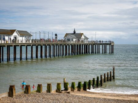 southwold: People Enjoying a Walk on Southwold Pier Editorial