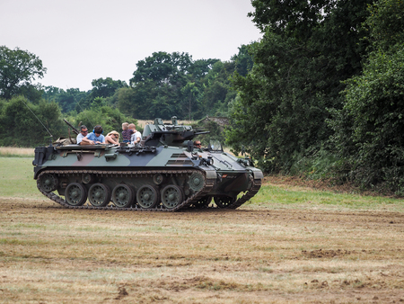 armoured: People Enjoying a Ride in an Armoured Car at Dunsfold Airfield Editorial