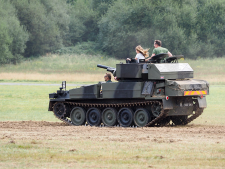 airfield: People Enjoying a Ride in an Armoured Car at Dunsfold Airfield Editorial