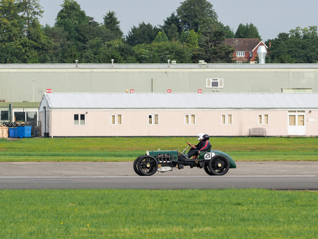 airfield: Vintage Car Driving around Dunsfold Airfield Editorial