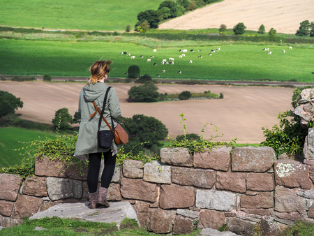 great plains: Woman Looking at the Cheshire Countryside from Beeston Castle