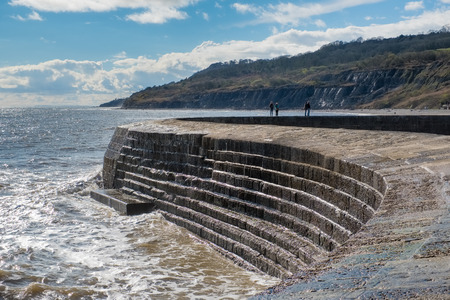 The Cobb Harbour Wall in Lyme Regis Stock Photo