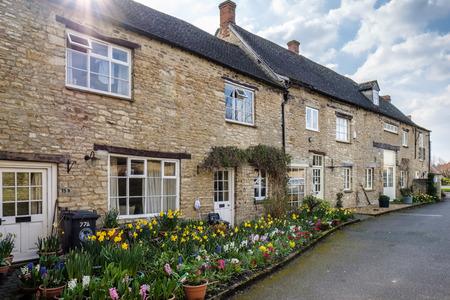Rij van Honing Gekleurde Huizen In Witney Stockfoto