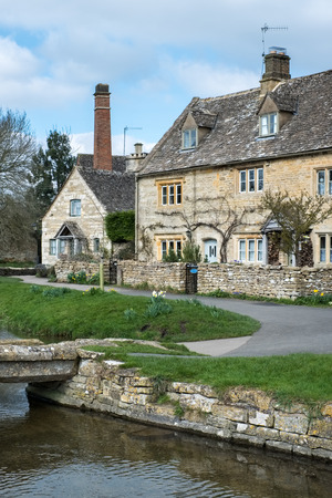 riverbank: Scenic View of Lower Slaughter Village in the Cotswolds