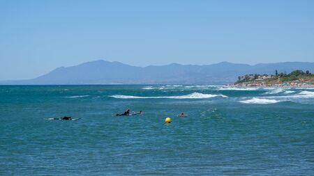CABO PINO, ANDALUCIASPAIN - JULY 2 : People Surfing at Cabo Pino Andalucía Spain on July 2, 2017. Unidentified people.