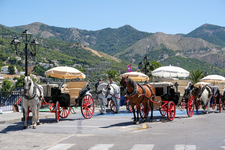 pueblo: MIJAS, ANDALUCIASPAIN - JULY 3 : Horse and Carriage in Mijas Andalucía Spain on July 3, 2017. Unidentified people.