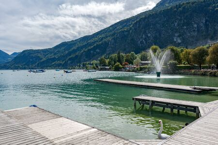 Fountain in Lake Wolfgang at St. Gilgen Stock Photo