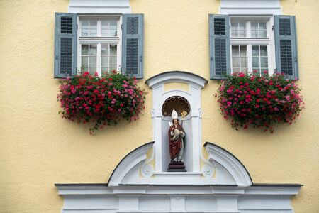 Statue of a Bishop on a Wall in St Wolfgang Stock Photo