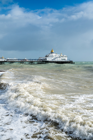 Tail End of Storm Brian Racing Past Eastbourne Pier in East Sussex Editorial