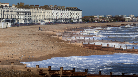 EASTBOURNE, EAST SUSSEXUK - JANUARY 7 : View of Buildings along the Seafront in Eastbourne East Sussex on January 7, 2018. Unidentified people