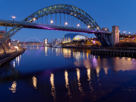 NEWCASTLE UPON TYNE, TYNE AND WEAR/UK - JANUARY 20 : View of the Tyne and Millennium Bridges at dusk in Newcastle upon Tyne, Tyne and Wear on January 20, 2018