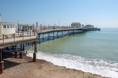 WORTHING, WEST SUSSEXUK - APRIL 20 : View of Worthing Pier in West Sussex on April 20, 2018. Unidentified people