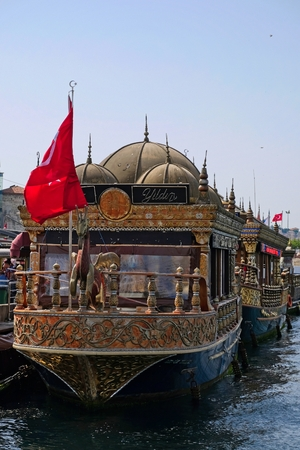 ISTANBUL, TURKEY - MAY 24 : View of Chinese floating restaurants along the Bosphorus in Istanbul Turkey on May 24, 2018. Two unidentified people Editorial