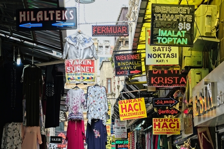 ISTANBUL, TURKEY - MAY 25 : Clothes and signs near the Grand Bazaar in Istanbul Turkey on May 25, 2018