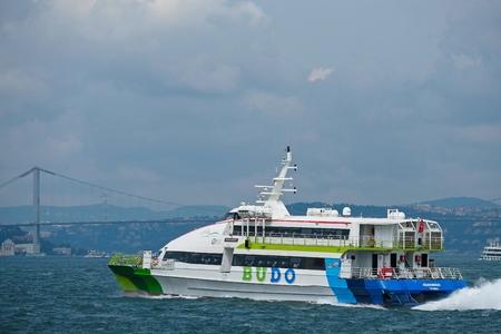 ISTANBUL, TURKEY - MAY 26 : Boat cruising up the Bosphorus in Istanbul Turkey on May 26, 2018