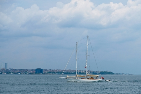View of ayacht sailing up the Bosphorus in Istanbul Turkey.One unidentified person Stock Photo