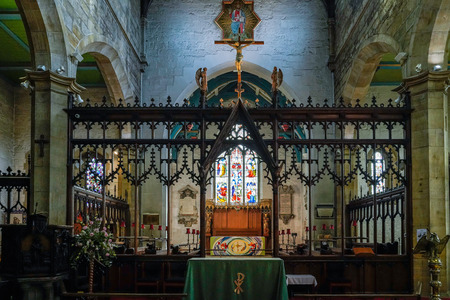 EAST GRINSTEAD,  WEST SUSSEXUK - AUGUST 18 :  Main altar in St Swithuns Church East Grinstead West Sussex on August 18, 2018