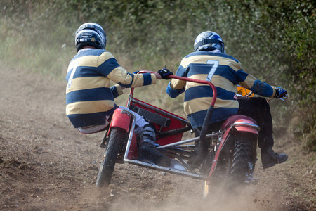 GOODWOOD, WEST SUSSEX/UK - SEPTEMBER 14 : Sidecar Motocross at the Goodwood Revival on September 14, 2012. Two unidentified people