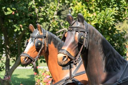CURTEA DE ARGES, WALLACHIAROMANIA - SEPTEMBER 16 : Plastic Horses in the Monastery grounds in Curtea de Arges Wallachia Romania on September 16, 2018