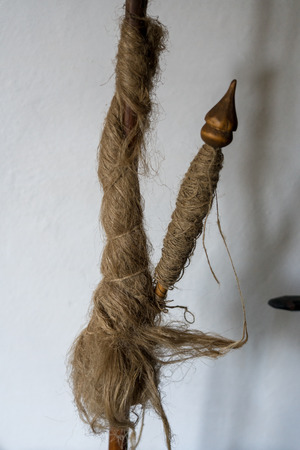 TARPESTI, MOLDOVIA/ROMANIA - SEPTEMBER 19 : Hemp on a spindle in the Neculai Popa Ethnographic Museum in Tarpesti in Moldovia Romania on September 19, 2018