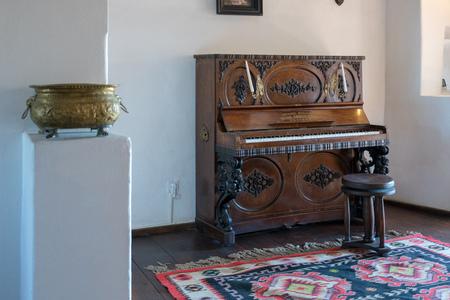 BRAN, TRANSYLVANIAROMANIA - SEPTEMBER 20 : View of a piano in Draculas Castle in Bran Transylvania Romania on September 20, 2018