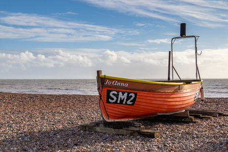 WORTHING, WEST SUSSEXUK - NOVEMBER 13 : View of a fishing boat on the beach in Worthing West Sussex on November 13, 2018 Editorial