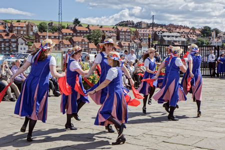 WHITBY NORTH YORKSHIRE/UK - AUGUST 22 : Women Morris Dancing in Whitby North Yorkshire on August 22, 2010. Unidentified people Editorial