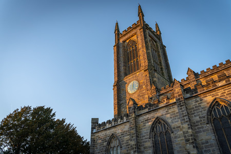 EAST GRINSTEAD, WEST SUSSEX/UK - JANUARY 15  : Evening sunlight on st Swithun's Church in East Grinstead on January 15, 2019