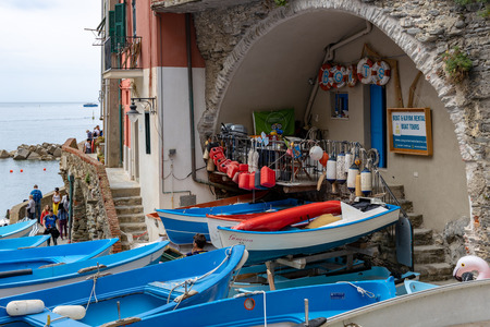 RIOMAGGIORE, LIGURIA/ITALY  - APRIL 21 : Boats by the sea in Riomaggiore Liguria Italy on April 21, 2019. Unidentified people Editorial