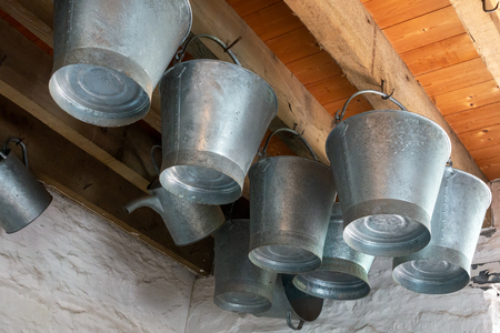 Galvanised buckets in an ironmongery shop at St Fagans in Cardiff