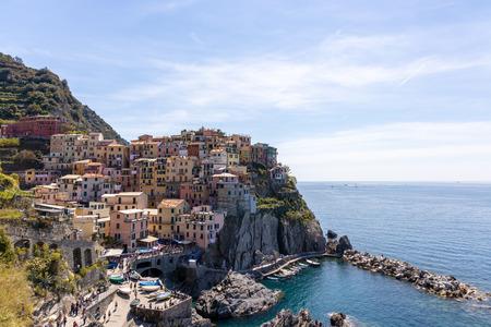 Coastal view of Manarola Liguria Italy. Unidentified people