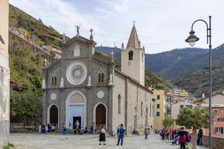 RIOMAGGIORE, LIGURIA/ITALY  - APRIL 21 : Church of San Giovanni Battista in Riomaggiore Liguria Italy on April 21, 2019. Unidentified people