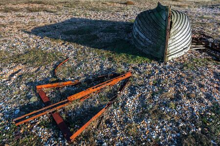 DUNGENESS, KENTUK - DECEMBER 17 :  Derelict Rowing Boat on Dungeness Beach in Kent on December 17, 2008