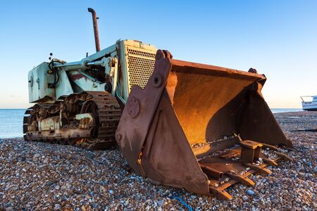 DUNGENESS, KENTUK _ DECEMBER 17 : Bulldozer on Dungeness beach in Kent on December 17, 2008