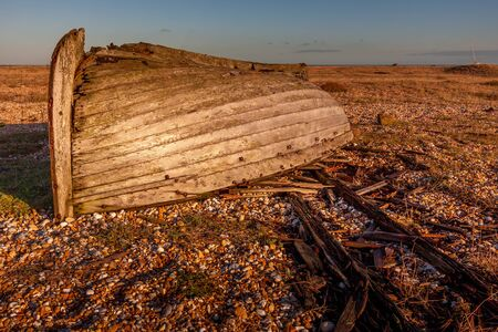 DUNGENESS, KENT/UK - DECEMBER 17 :  Derelict Rowing Boat on Dungeness Beach in Kent on December 17, 2008 写真素材