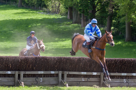 GODSTONE, SURREYUK - MAY 2 : Point to point racing at Godstone Surrey on May 2, 2009. Two unidentified people