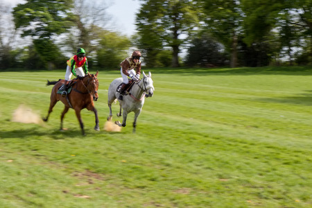 GODSTONE, SURREYUK - MAY 2 : Point to point racing at Godstone Surrey on May 2, 2009. Four unidentified people