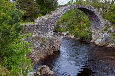 CARRBRIDGE, BADENOCH and STRATHSPEYSCOTLAND - MAY 21 : Packhorse bridge at Carrbridge Scotland on May 21, 2011