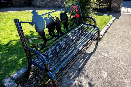 ST DAVIDS, PEMBROKESHIREUK - SEPTEMBER 13 : A new commemorative bench in the gardens at St Davids in Pembrokeshire on September13, 2019